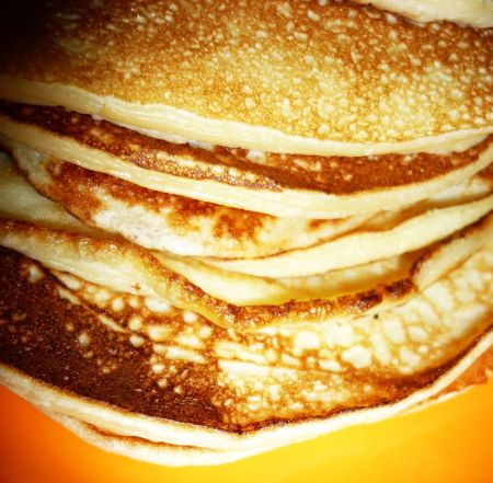 pancakes on orange plate 22